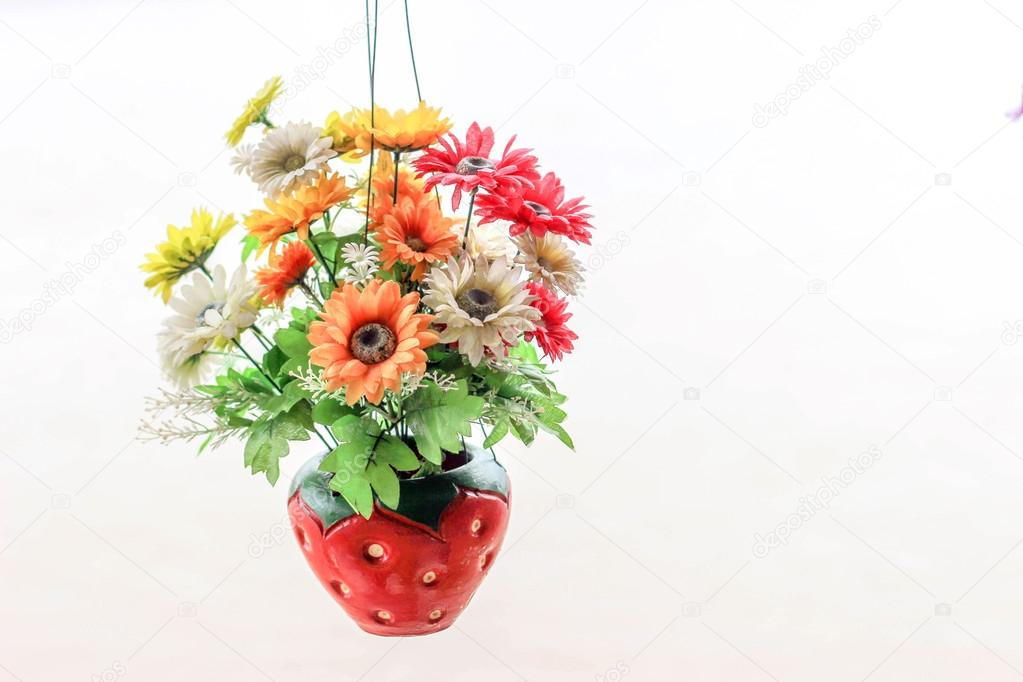 Artificial Flowers In Strawberry Vase Hanging On White Stock Photo