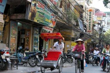 Citizens commute across Hanoi city