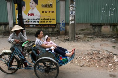 A lady and child on a trishaw