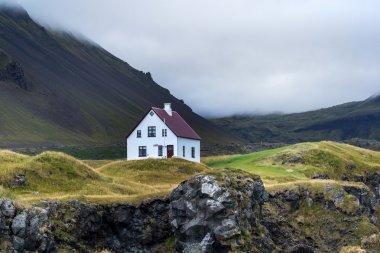 Farmhouse on hill in Iceland
