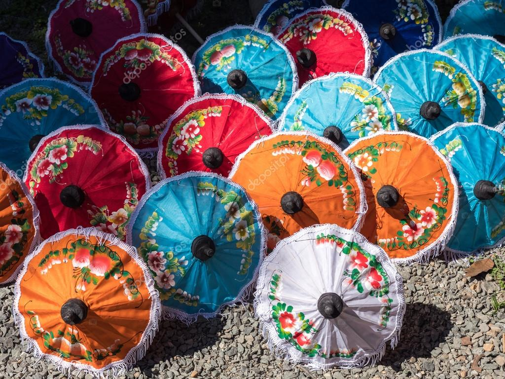 painted parasols dry in the sun