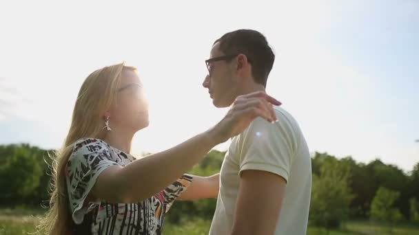 Loving couple in sunglasses at sunset slow motion