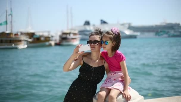 Mother and daughter on vacation photographed beside the Adriatic Sea in Croatia in the port city of Split