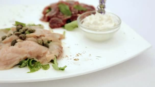 Appetizer of fresh raw tuna and sword fish. Close up. HD shot with slider