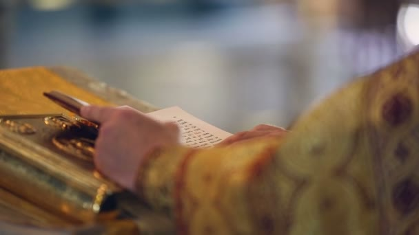 Reading the Holy Gospel. Hands Orthodox priest turns the page