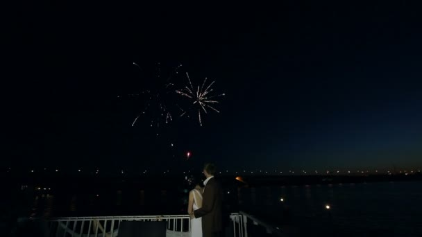 Happy wedding couple watching fireworks salute. Sequence