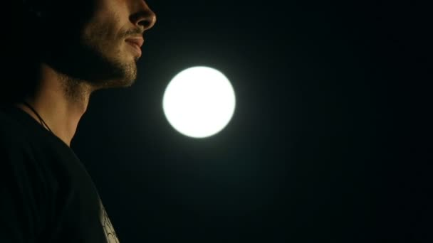 Silhouette of a man who prays in the moonlight