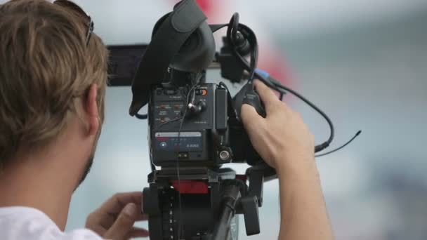 Cameraman filming scenes in the rain
