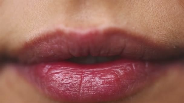 SLOW MOTION: Close up of a beautiful female lips. Girl showing braces on teeth.