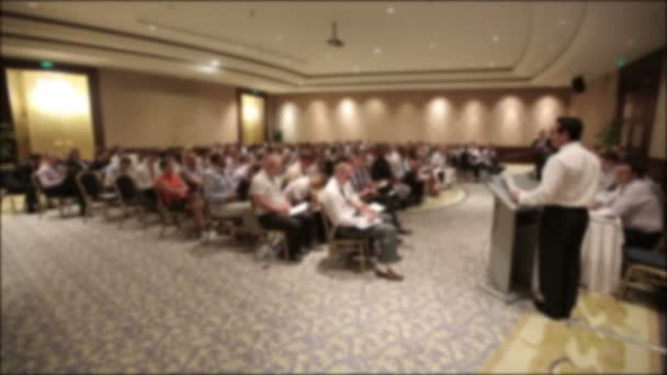Many people came together at a conference or seminar. Blurred background for title.