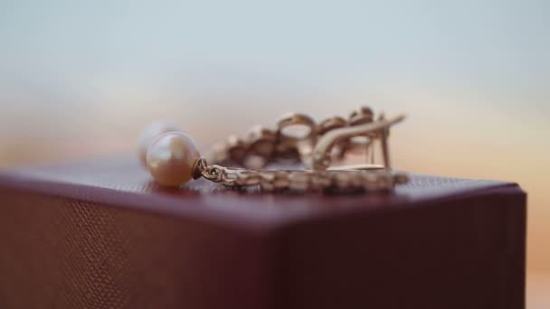 Gold earrings with pearls close up macro