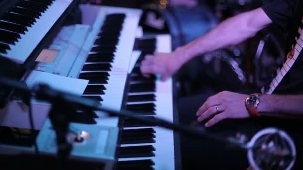 Musician plays a synthesizer
