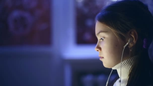 Portrait of child used the computer at night. Model Elizabeth Andreeva