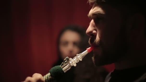 Man smoking shisha or hookah. Close up