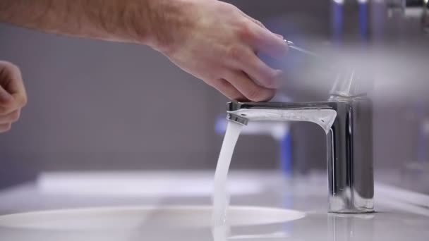A man washes his hands. Slow motion