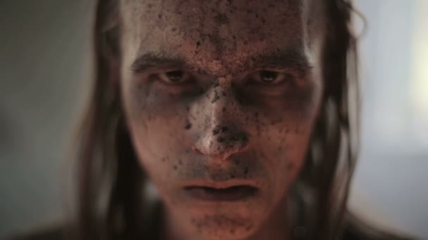 Portrait of a military mans face in blood and dirt