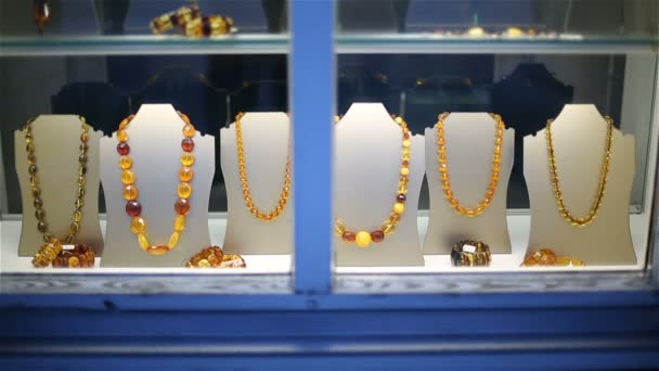 Amber beads and bracelets on a show-window of shop of jewelry