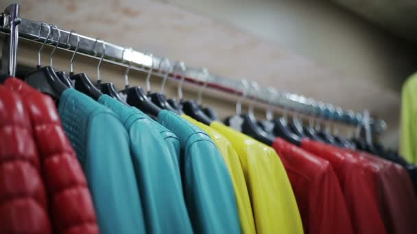 Collection of leather jackets on hangers at shop