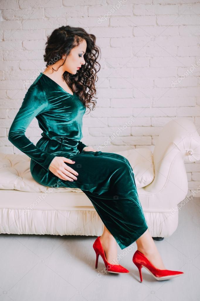 Beautiful model in emerald velvet dress