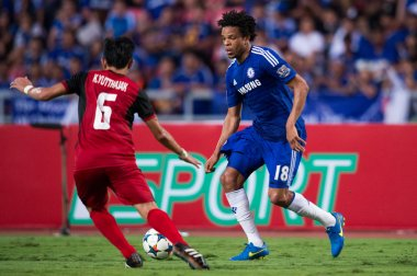 Loic Remy (blue) of Chelsea in action