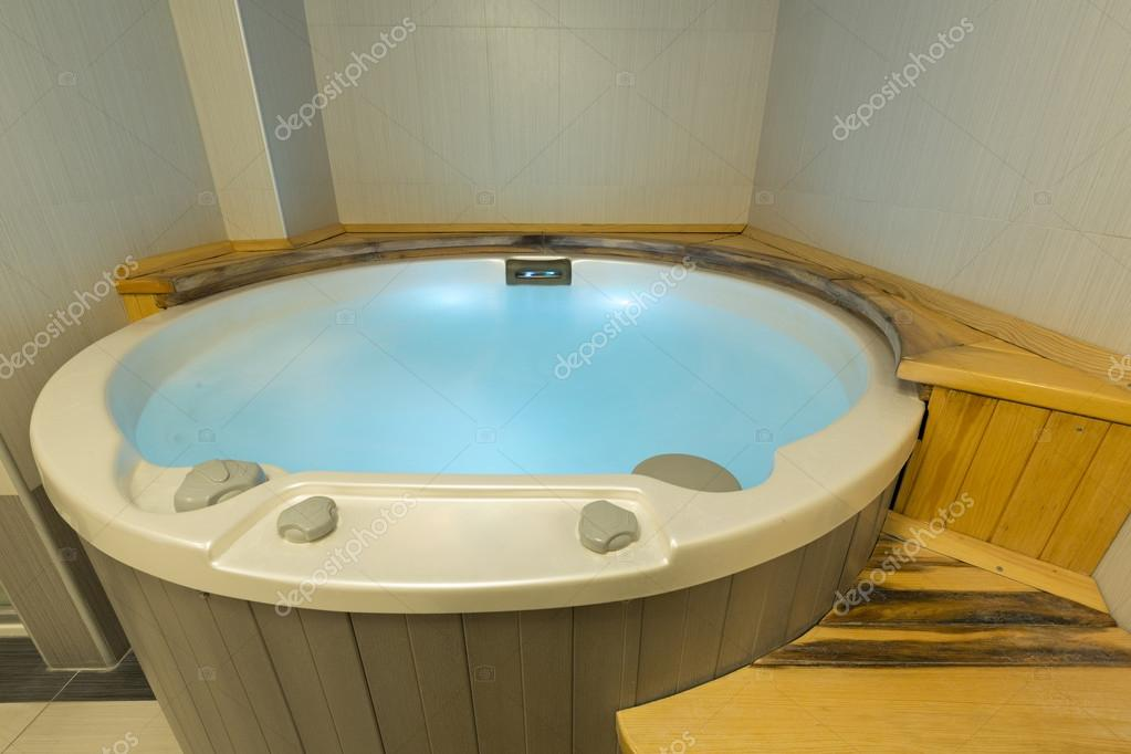 Jacuzzi bath in spa wellness center — Stock Photo © rilueda #103553000