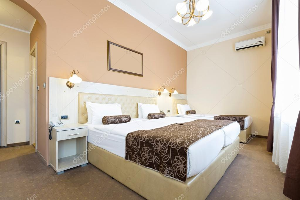 Hotel Room With Single And Double Bed Stock Photo C Rilueda
