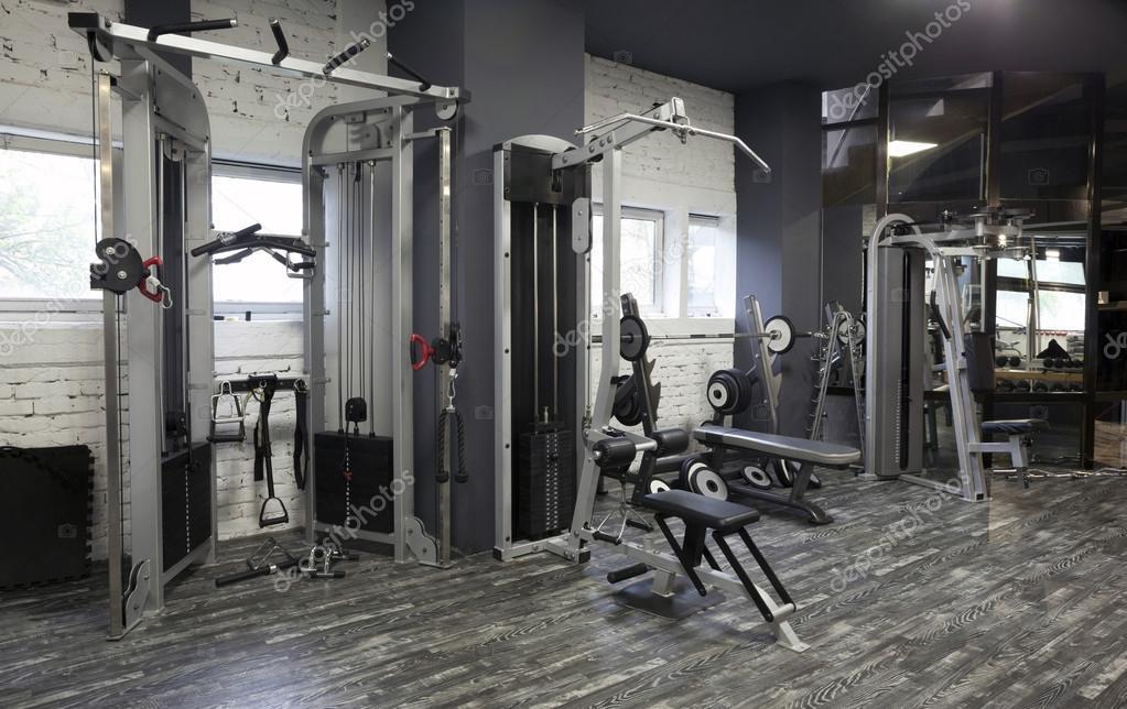 appareils d 39 exercice dans une salle de sport photographie rilueda 53583885. Black Bedroom Furniture Sets. Home Design Ideas