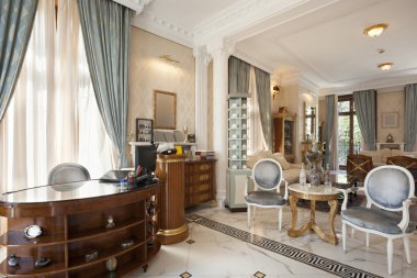 Small fancy hotel lobby with reception desk