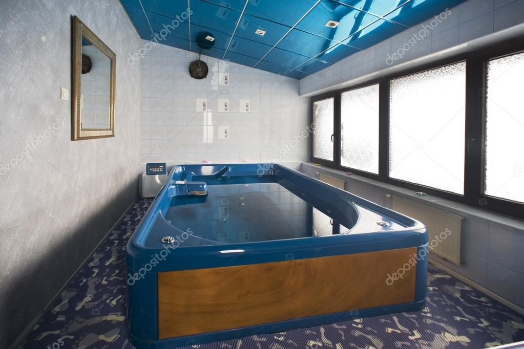 Big hydrotherapy tub in spa center — Stock Photo © rilueda #59012807