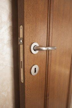 Doorknob and lock on wooden door