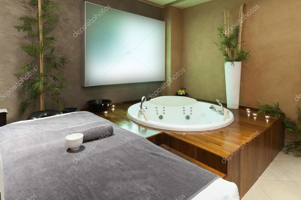 Massage bed and jacuzzi in modern spa u stock photo rilueda