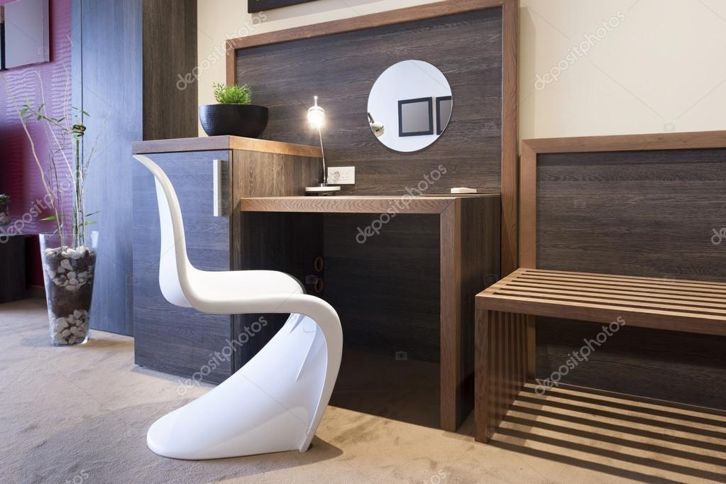 Desk and chair in luxury hotel room interior