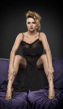 Sexy woman posing on sofa