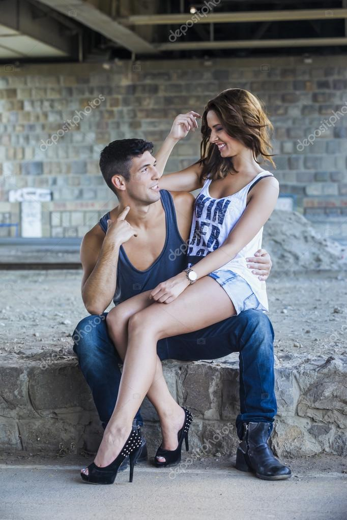 Young woman sitting in boyfriends lap — Stock Photo #77451338