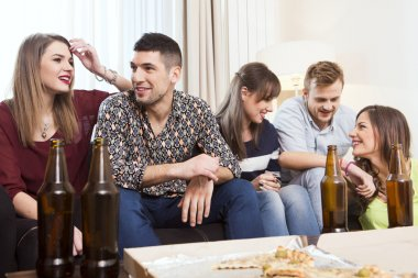 Group of friends hanging out at home