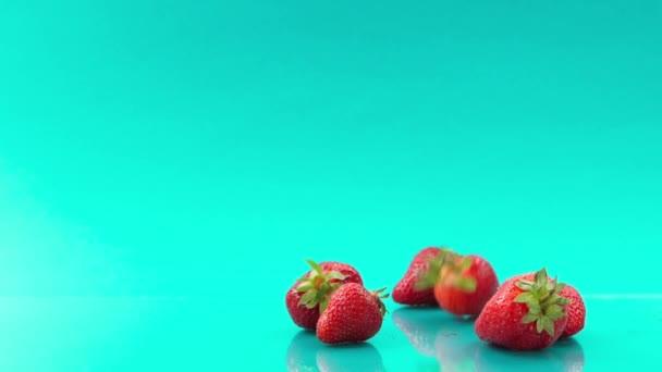 strawberry on turquoise background