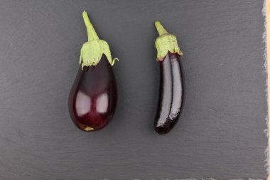 freshly picked eggplant on an old wooden surface. Rustic take.