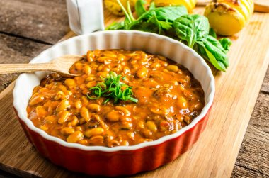 Spicy cowboy beans with hassleback potatoe with herbs