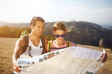 Male and female hikers are walking together in mountains during long awaiting summer weekend