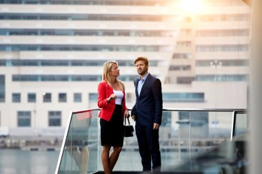 Skilled leaders stand outside of company