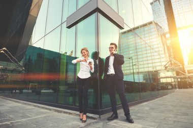 Cheerful man boss and female secretary