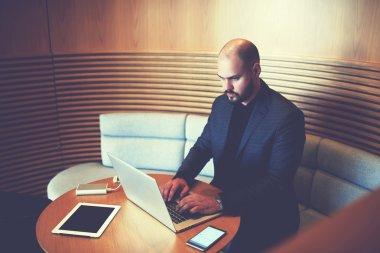 serious businessman using portable laptop