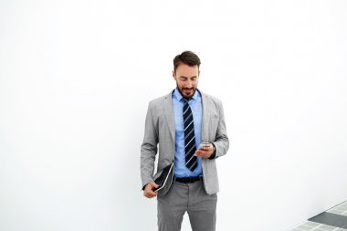 Skilled businessman is standing near copy space for your advertising text message or content
