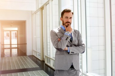 Male entrepreneur is pondering about something before meeting with important customers