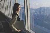 Fotografie Female successful entrepreneur with laptop computer