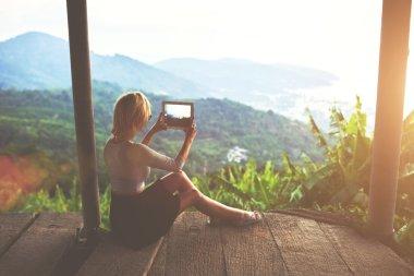 Female traveler shooting video