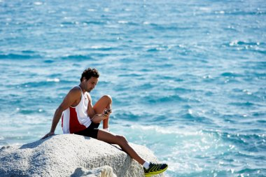 Male runner enjoying amazing sea