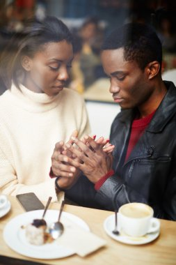 Two people in cafe enjoying the time spending with each other, portrait of young couple in love at coffee shop, young couple at san valentines day, handsome man declaration of love for his girlfriend