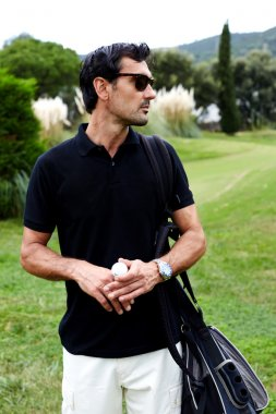 golfer man in glasses
