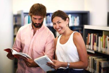 couple of international students holding books